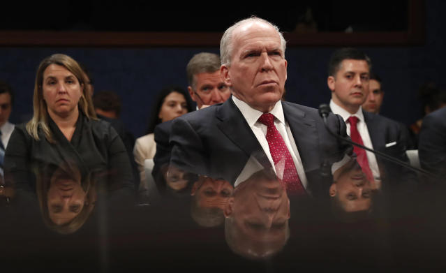 <p>Former CIA Director John Brennan is reflected in a table as he prepares to testify on Capitol Hill in Washington, May 23, 2017, before the House Intelligence Committee Russia Investigation Task Force. (Photo: Martinez Monsivais/AP) </p>