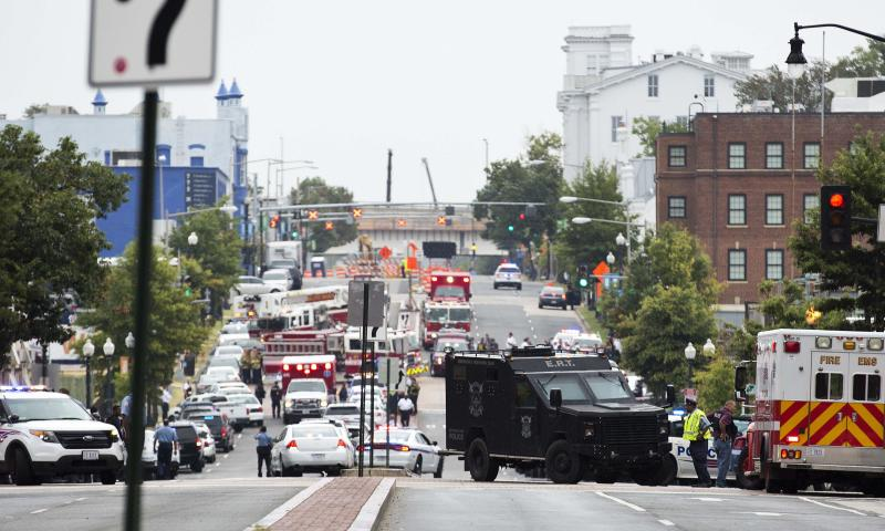 Police block off the M Street, SE, as they respond to a shooting at the Washington Navy Yard in Washington