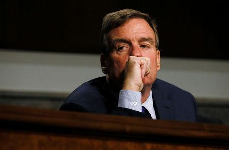 Senate Intelligence Committee Vice Chairman Senator Mark Warner listens to testimony from Twitter CEO Jack Dorsey and Facebook COO Sheryl Sandberg at a hearing on foreign influence operations on social media platforms on Capitol Hill in Washington, U.S., September 5, 2018. REUTERS/Jim Bourg/File Photo