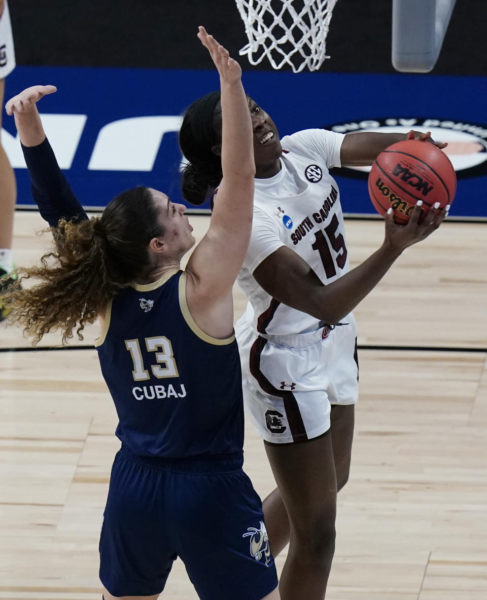 South Carolina forward Laeticia Amihere (15) shoots past Georgia Tech forward Lorela Cubaj (13) during the first half of a college basketball game in the Sweet Sixteen round of the women's NCAA tournament at the Alamodome in San Antonio, Sunday, March 28, 2021. (AP Photo/Eric Gay)
