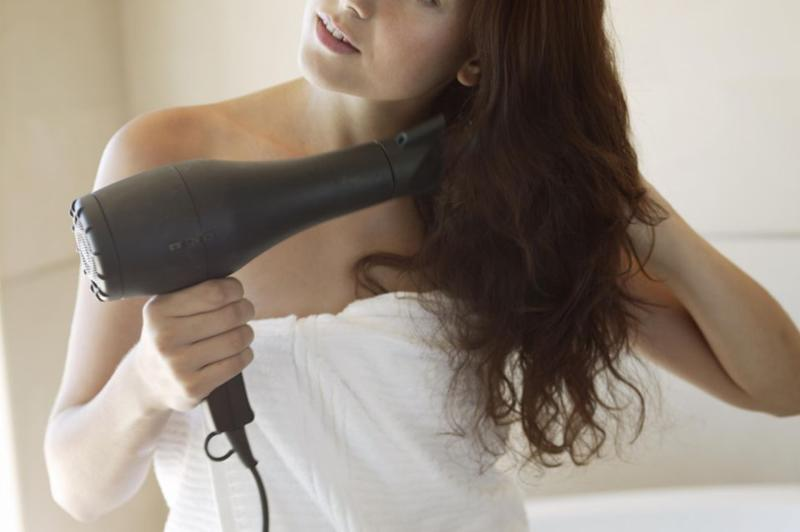 Hate blowdrying your hair? We've got the hack for you. Photo: Getty