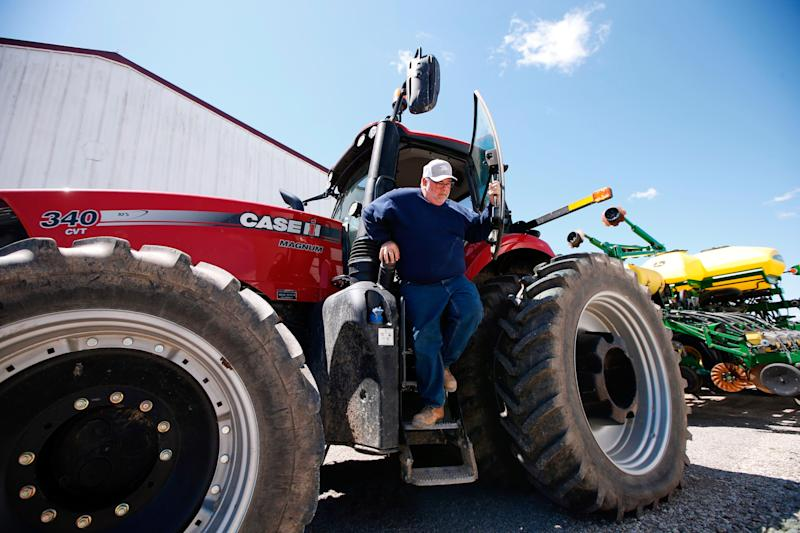 Bret Davis, a soybean farmer, steps out of his tractor in Delaware, Ohio, on Tuesday, May 14, 2019. Some farmers fear the protracted trade war with China will permanently alter their sales, leaving them without a foothold in one of their largest markets. (AP Photo/Angie Wang)