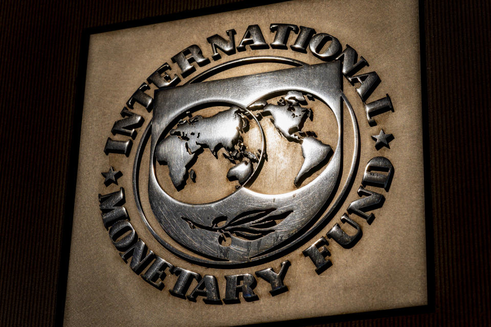 The logo of the International Monetary Fund is visible on their building, Monday, April 5, 2021, in Washington. The IMF and the World Bank open their virtual spring meetings. (AP Photo/Andrew Harnik)