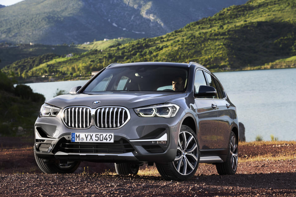 This undated photo from BMW shows the X1, an extra-small luxury SUV that gets an EPA-estimated 27 mpg in mixed driving conditions. If you want an affordable luxury SUV that can also hold a lot of your stuff, BMW's entry-level SUV, the X1, could be the vehicle for you. Its interior is roomy for passengers and offers 27.1 (minimum) and 58.7 (maximum) cubic feet of storage. (Günter Schmied/BMW of North America via AP)
