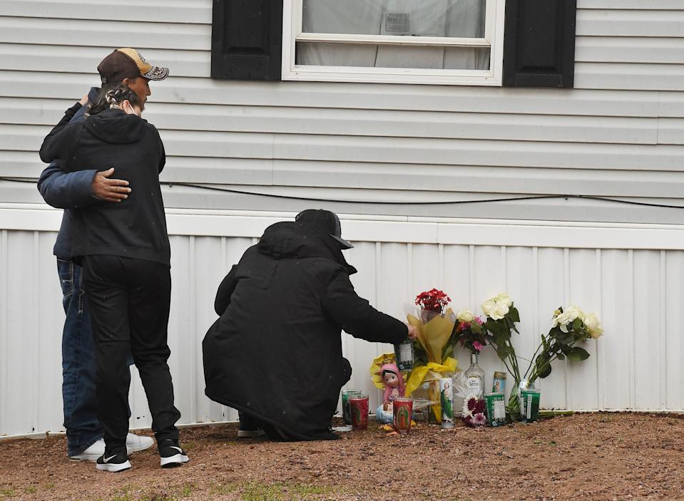 Mourners organize a memorial, Monday, May 10, 2021, outside a mobile home in Colorado Springs, Colo., where a shooting at a party took place a day earlier that killed six people before the gunman took his own life.