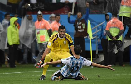 Argentina's Maxi Rodriguez celebrates with Sergio Romero after their team's semifinal win. (AFP)