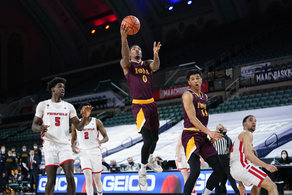 Iona's Berrick JeanLouis (0) goes up for a shot in the first half of an NCAA college basketball game against Fairfield during the finals of the Metro Atlantic Athletic Conference tournament, Saturday, March 13, 2021, in Atlantic City, N.J. (AP Photo/Matt Slocum)