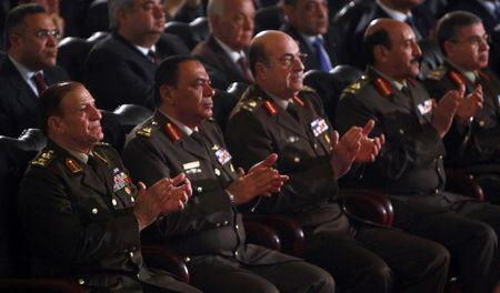 FILE PHOTO: General Sami Anan (L), Army chief of Staff and member of the SCAF at the Supreme Council of the Armed Forces, and other high-ranking military officials attend the Coptic Christmas eve mass at the main cathedral in Cairo, Egypt January 6, 2012. REUTERS/Amr Abdallah Dalsh/File Photo