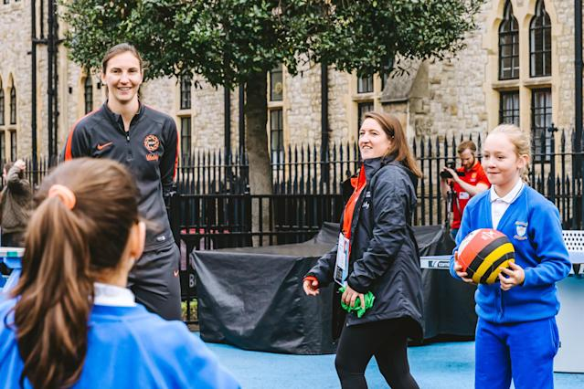Rachel Dunn watching children play netball at the TeamUp event in Marylebone