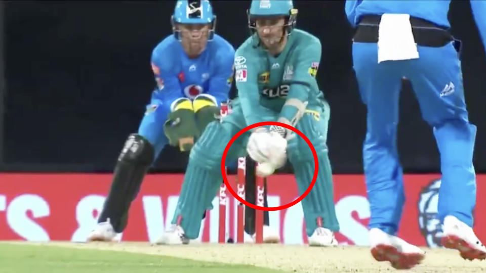 Brisbane Heat batsman Tom Cooper bottom-edged this attempted reverse sweep, but was nonetheless given out LBW in their BBL clash against Adelaide. Picture: Fox Sports