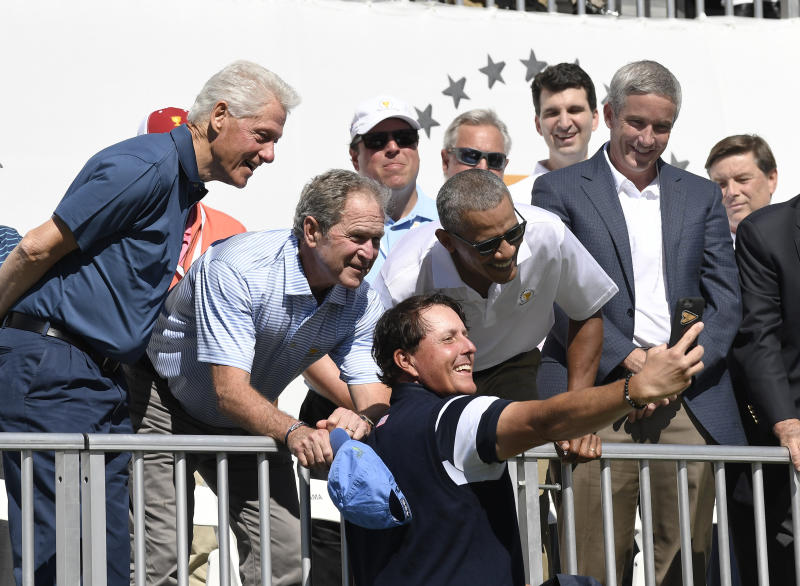 Former Presidents Bill Clinton, George W. Bush and Barack Obama pose for a selfie with Phil Mickelson of the U.S. Team during the 2017 Presidents Cup. (Chris Condon via Getty Images)