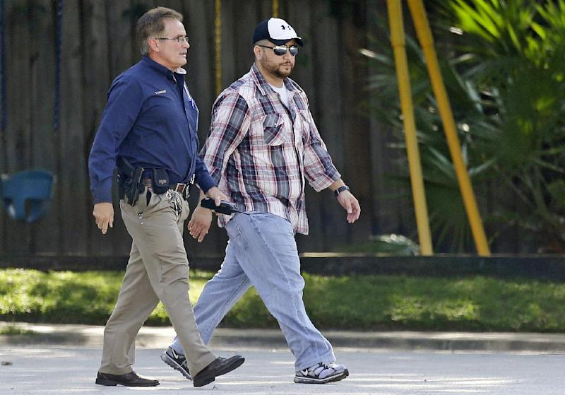 """In this Monday, Sept. 9, 2013 file photo, George Zimmerman, right, is escorted to a home by a Lake Mary police officer, in Lake Mary, Fla., after a domestic incident in the neighborhood where Zimmerman and his wife Shellie had lived during his murder trial. Whether they think he got away with murdering 17-year-old Trayvon Martin or that he was just a brave neighborhood watch volunteer """"standing his ground,"""" many Americans can't seem to get enough of George Zimmerman. And he can't seem to stop giving it to them. (AP Photo/John Raoux, File)"""