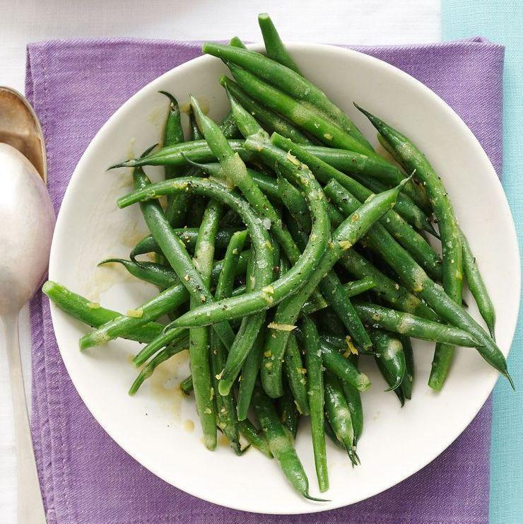 """<p>These zingy, lemony beans will balance all of the meat and potatoes on the table.</p><p><em><a href=""""https://www.goodhousekeeping.com/food-recipes/a15650/green-beans-lemon-vinaigrette-recipe-wdy0414/"""" rel=""""nofollow noopener"""" target=""""_blank"""" data-ylk=""""slk:Get the recipe for Green Beans with Lemon Vinaigrette »"""" class=""""link rapid-noclick-resp"""">Get the recipe for Green Beans with Lemon Vinaigrette »</a></em></p>"""