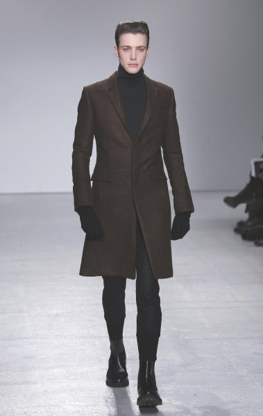 A model wears a creation by South Korean fashion designer Juun. J as part of his presentation for Men's 2013 fall-winter 2013/2014 men's fashion collection, presented in Paris, Friday, Jan.18, 2013. (AP Photo/Jacques Brinon)