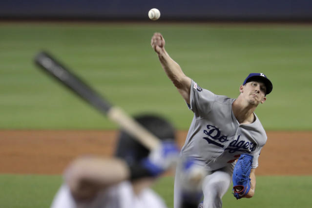 Los Angeles Dodgers starting pitcher Walker Buehler delivers to Miami Marlins' Garrett Cooper during the first inning of a baseball game, Thursday, Aug. 15, 2019, in Miami. (AP Photo/Lynne Sladky)