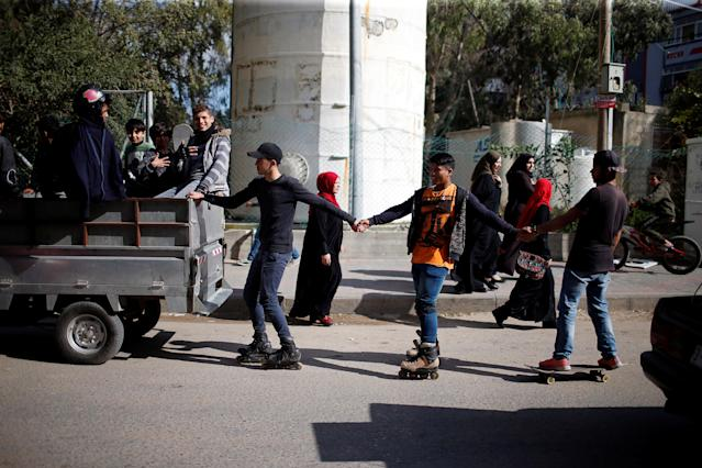 Members of Gaza Skating Team, Mohammad Al-Sawalhe, 23, and Mustafa Sarhan, 19, practice their rollerblading and skating skills on a street in Gaza City March 10, 2019. Picture taken March 10, 2019. REUTERS/Mohammed Salem