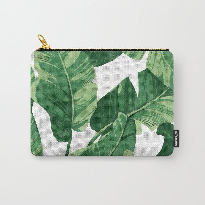 """<p><strong>Society6</strong></p><p>society6.com</p><p><strong>$13.59</strong></p><p><a href=""""https://go.redirectingat.com?id=74968X1596630&url=https%3A%2F%2Fsociety6.com%2Fproduct%2Ftropical-banana-leaves-iv_carry-all-pouch&sref=https%3A%2F%2Fwww.housebeautiful.com%2Fshopping%2Fg29038509%2Fgolden-girls-gift-ideas%2F"""" rel=""""nofollow noopener"""" target=""""_blank"""" data-ylk=""""slk:Shop Now"""" class=""""link rapid-noclick-resp"""">Shop Now</a></p>"""