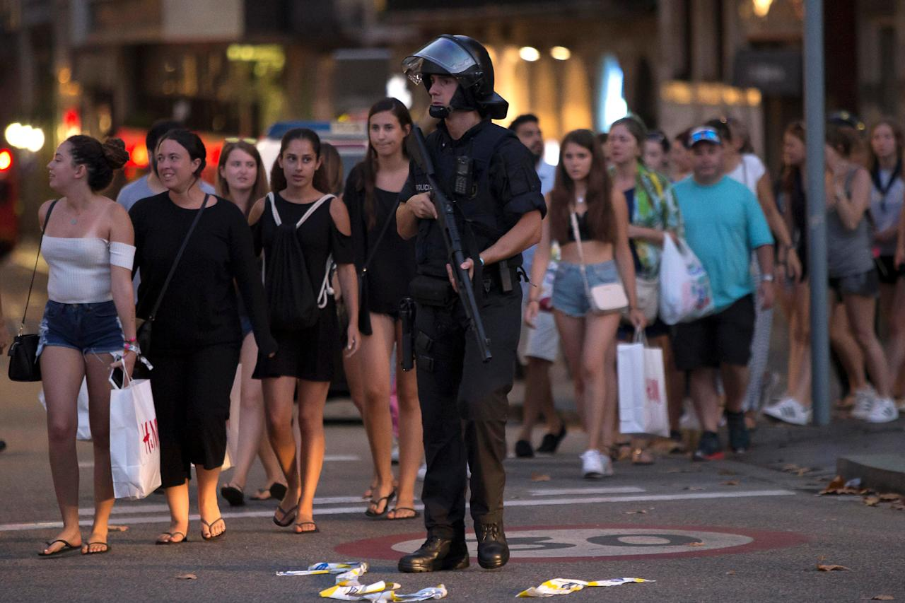 <p>Police evacuate people after a van crashed into pedestrians near the Las Ramblas avenue in central Barcelona, Spain Aug. 17, 2017. (Reuters/Stringer) </p>
