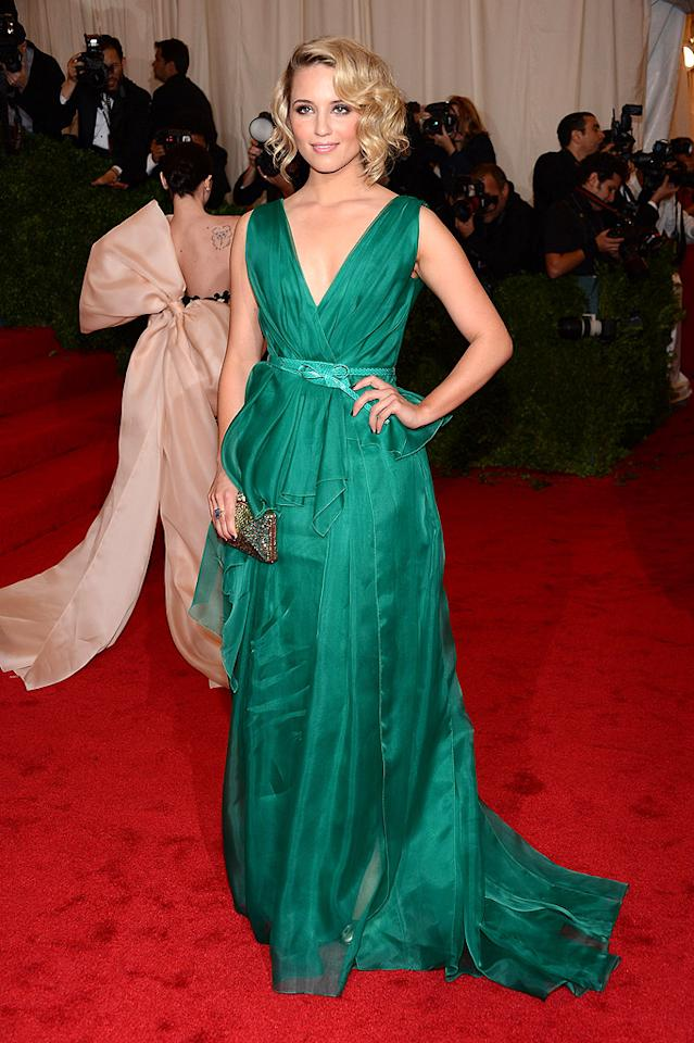 "<p class=""MsoNoSpacing"">""Glee"" actress Dianna Agron stunned in an emerald green Carolina Herrera gown with a low-cut neckline and mint-colored belt and Judith Leiber gold clutch.</p><p class=""MsoNoSpacing""></p><p class=""MsoNoSpacing""></p>"