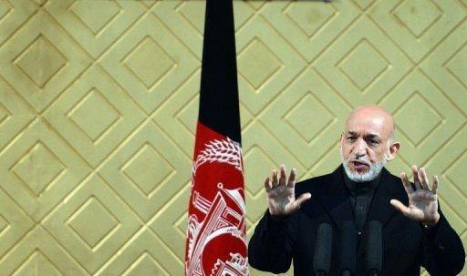 Afghan President Hamid Karzai talks during a ceremony to mark the 80th anniversary of Kabul University on May 9, 2013. Karzai has vowed to wring concessions from the United States in negotiations to sign a security pact, saying Washington wanted to retain nine military bases in the country