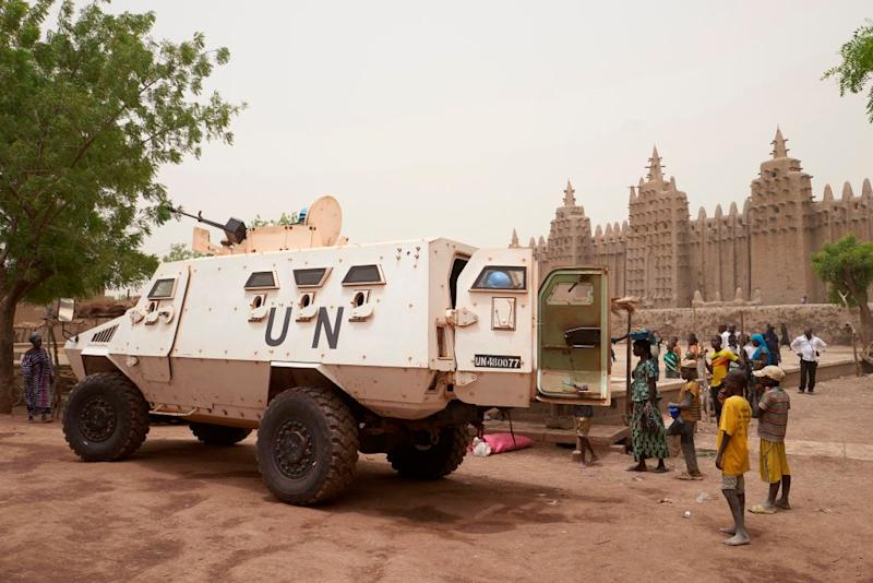 An armoured vehicle of the United Nations Multidimensional Integrated Stabilisation Mission in Mali (MINUSMA) patrols during the annual rendering of the Great Mosque of Djenne in central Mali, on April 28, 2019. | Michele Cattani—AFP/Getty Images