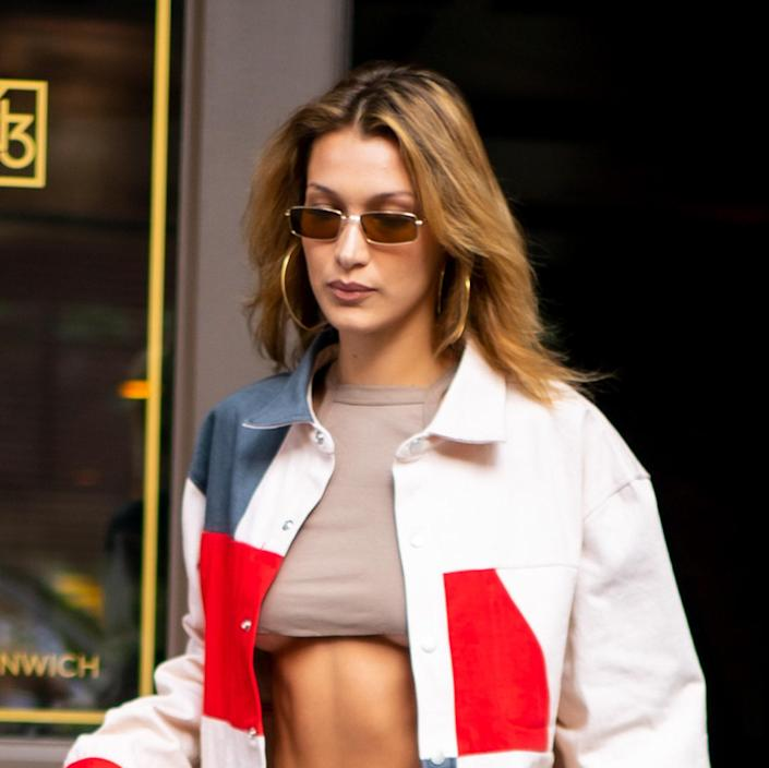 """<p>After a lifetime as a brunette, Bella Hadid is coming for her sister Gigi's blonde throne. <a href=""""https://www.allure.com/story/bella-hadid-golden-blonde-hair-color?mbid=synd_yahoo_rss"""" rel=""""nofollow noopener"""" target=""""_blank"""" data-ylk=""""slk:This warm-toned gold"""" class=""""link rapid-noclick-resp"""">This warm-toned gold</a> complements her natural dark shade, and Hadid has left her roots intact to keep the overall look squarely in between brown and blonde. </p> <p>This is a nice option for anyone looking to try out life as a blonde or brighten up a chestnut brown. """"Ask your colorist for a suitable golden shade for your skin tone,"""" says <a href=""""https://shop-links.co/1746212413319675681gCEAE"""" rel=""""nofollow noopener"""" target=""""_blank"""" data-ylk=""""slk:Kevin Murphy"""" class=""""link rapid-noclick-resp"""">Kevin Murphy</a> global design director <a href=""""https://www.instagram.com/hairfashionstyler/?hl=en"""" rel=""""nofollow noopener"""" target=""""_blank"""" data-ylk=""""slk:Katie Reid"""" class=""""link rapid-noclick-resp"""">Katie Reid</a>. """"Your colorist could work a variety of natural golds to brighter golden tones by glossing over your lightened hair."""" If your skin has a neutral undertone like Hadid's, you can pretty much pull off any color. But Reid recommends asking your colorist to create a face-framing highlight that sits <strong>MISSING A WORD HERE MAYBE?</strong> for an even more flattering look.</p>"""