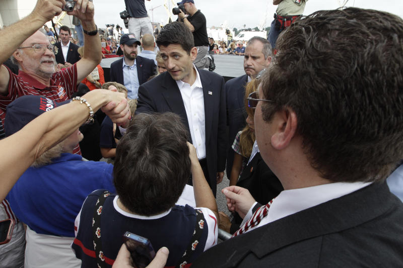 Wisconsin Rep. Paul Ryan, center, newly announced running mate of Republican presidential candidate, former Massachusetts Gov. Mitt Romney, greets the crowd while campaigning Saturday, Aug. 11, 2012 in Norfolk, Va. (AP Photo/Mary Altaffer)