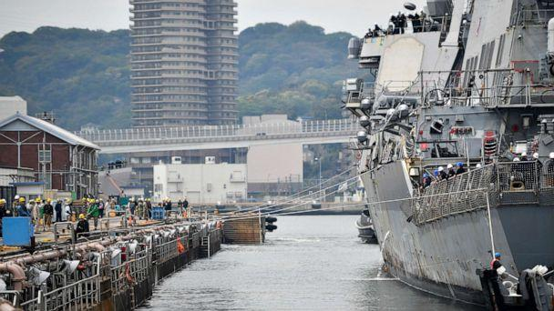 PHOTO: The Arleigh Burke-class guided missile destroyer USS Benfold (DDG65) is pulled into a dry dock at Commander, Fleet Activities Yokosuka. (William Collins III/US Navy)
