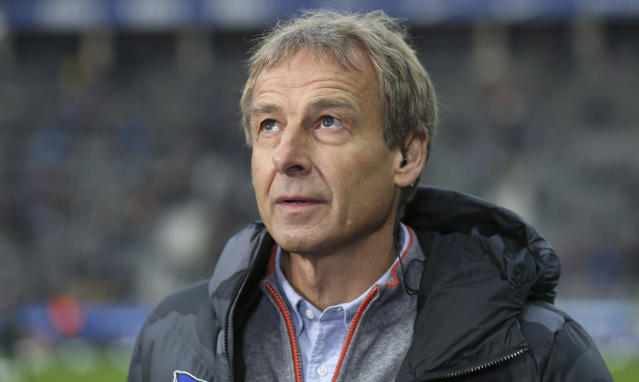Berlin's head coach Juergen Klinsmann looks up before the start of the German Bundesliga soccer match between Hertha BSC Berlin and Borussia Dortmund in Berlin, Germany, Saturday, Nov. 30, 2019. (Andreas Gora/dpa via AP)