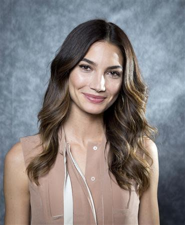 2014 Sports Illustrated cover model Lily Aldridge poses for a portrait in New York February 18, 2014. REUTERS/Carlo Allegri