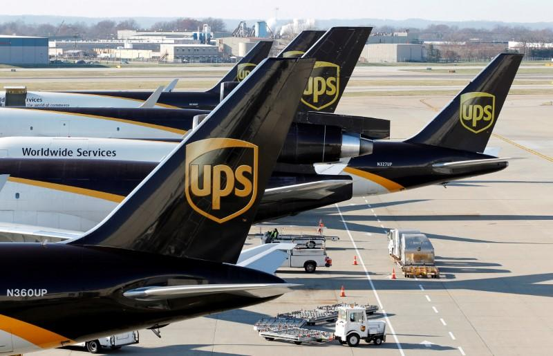 UPS profit rises on ecommerce, price hikes but shares fall