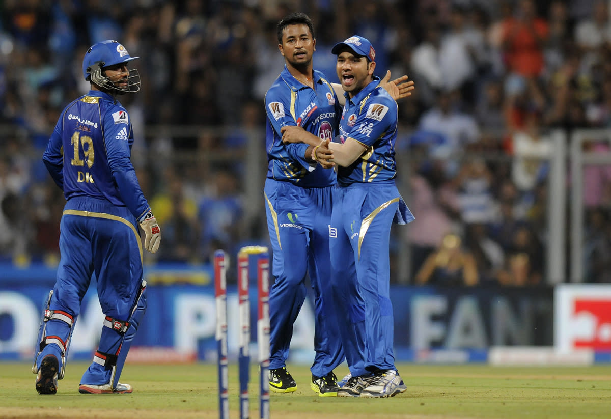 Pragyan Ojha of Mumbai Indians celebrates the wicket of Yusuf Pathan of Kolkata Knight Riders during match 53 of the Pepsi Indian Premier League ( IPL) 2013  between The Mumbai Indians and the Kolkata Knight Riders held at the Wankhede Stadium in Mumbai on the 7th May 2013 ..Photo by Pal Pillai-IPL-SPORTZPICS  ..Use of this image is subject to the terms and conditions as outlined by the BCCI. These terms can be found by following this link:..https://ec.yimg.com/ec?url=http%3a%2f%2fwww.sportzpics.co.za%2fimage%2fI0000SoRagM2cIEc&t=1506384470&sig=RPpaAp_N5bfjCE6r1oXsmA--~D