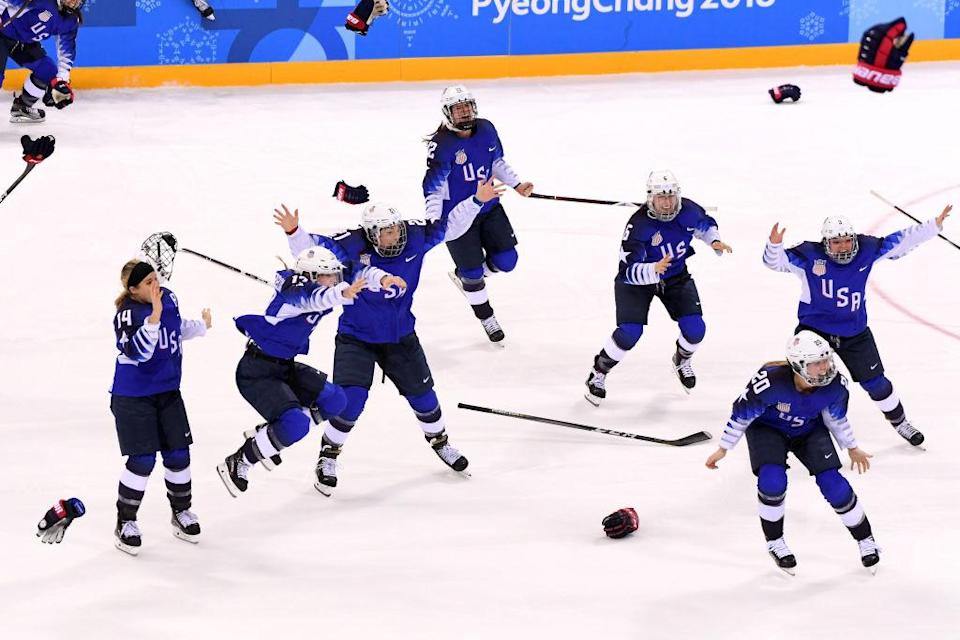 Team USA celebrates its first women's hockey gold medal in 20 years after beating Canada 3-2 in a shootout. (Getty)