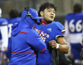 Edinburg's Emmanuel Duron is pulled from the field by coaching staff after charging a referee during a high school football zone play-in game against Pharr-San Juan-Alamo on Thursday, Dec. 3, 2020, in Edinburg, Texas. Duron came running from the sideline area after the referee announced his ejection, slamming into the official. Duron was escorted from the stadium by police. (Joel Martinez/The Monitor via AP)
