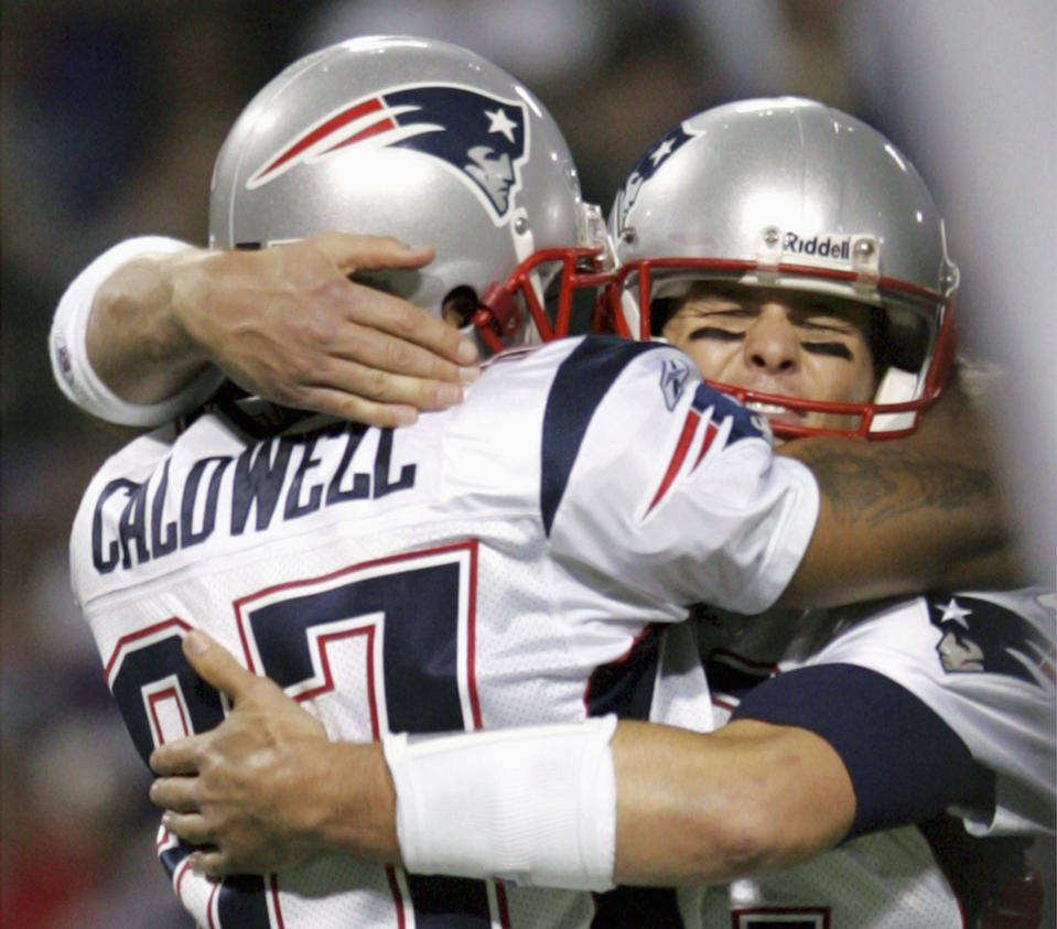 New England Patriots quarterback Tom Brady, right, once had Reche Caldwell as his go-to receiver in 2006. (REUTERS/Eric Miller)