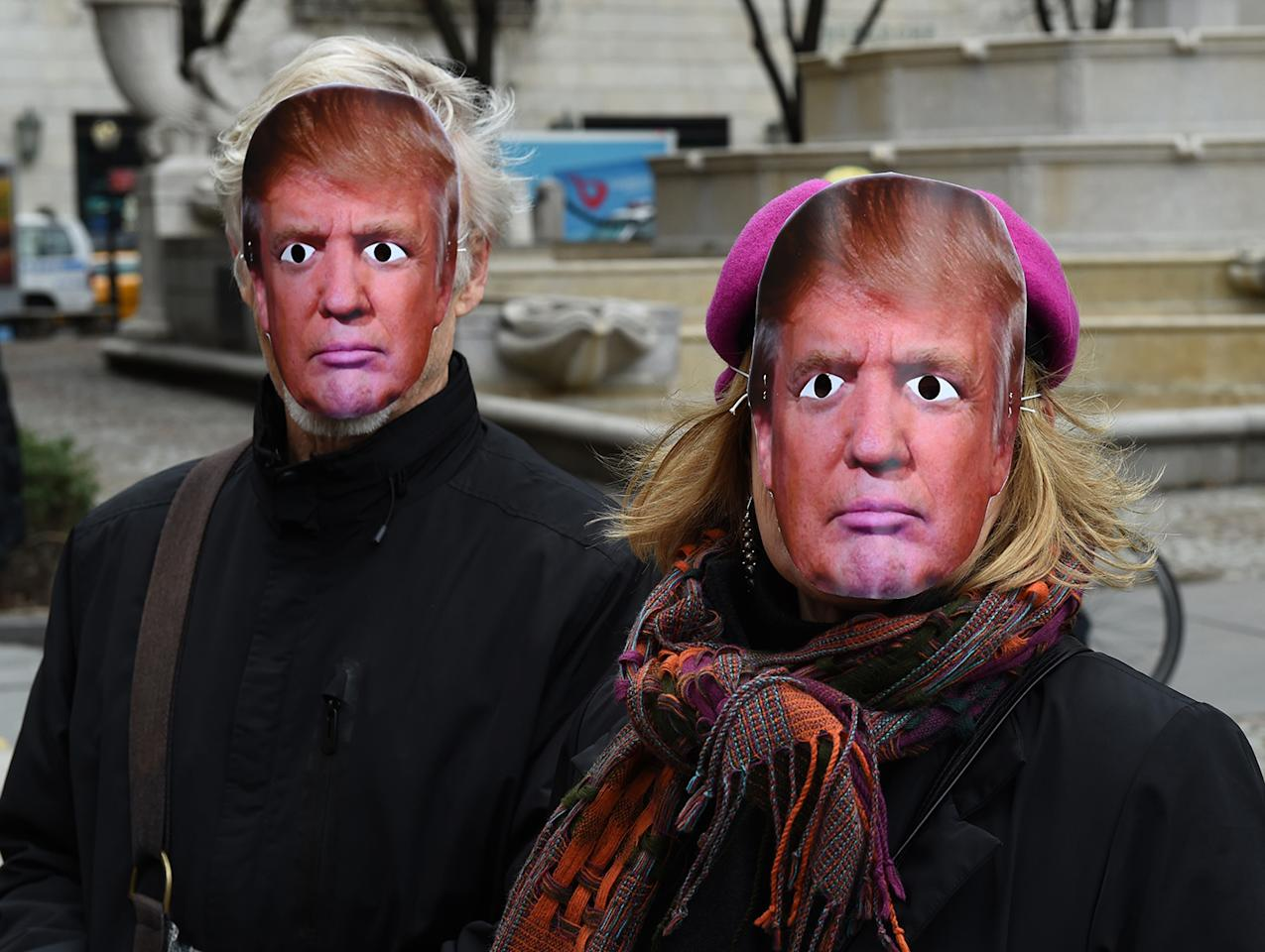 <p>People wearing masks of U.S. President Donald Trump take part in the 32nd Annual April Fools Day Parade in New York on April 1, 2017. (Photo: Timothy A. Clary/AFP/Getty Images) </p>
