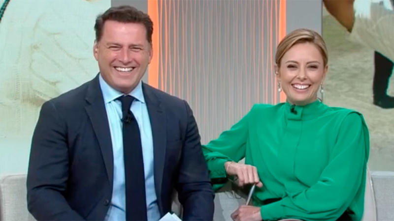 Karl Stefanovic in suit and Ally Langford in green shirt smile on Today 2020