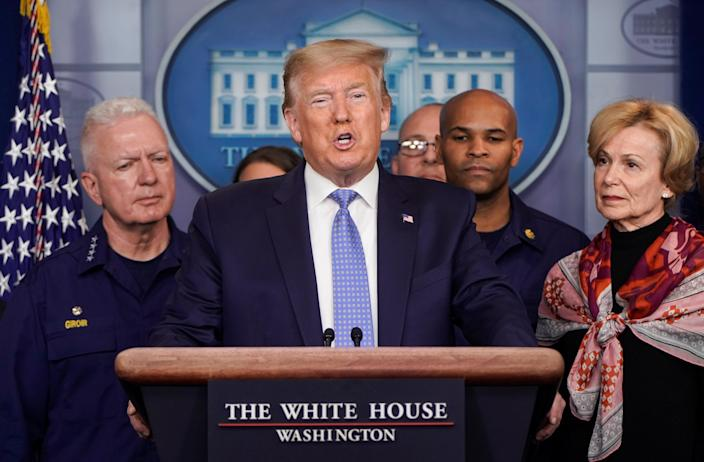 President Trump gives a news briefing on the administration's response to the coronavirus at the White House on Sunday. (Joshua Roberts/Reuters)