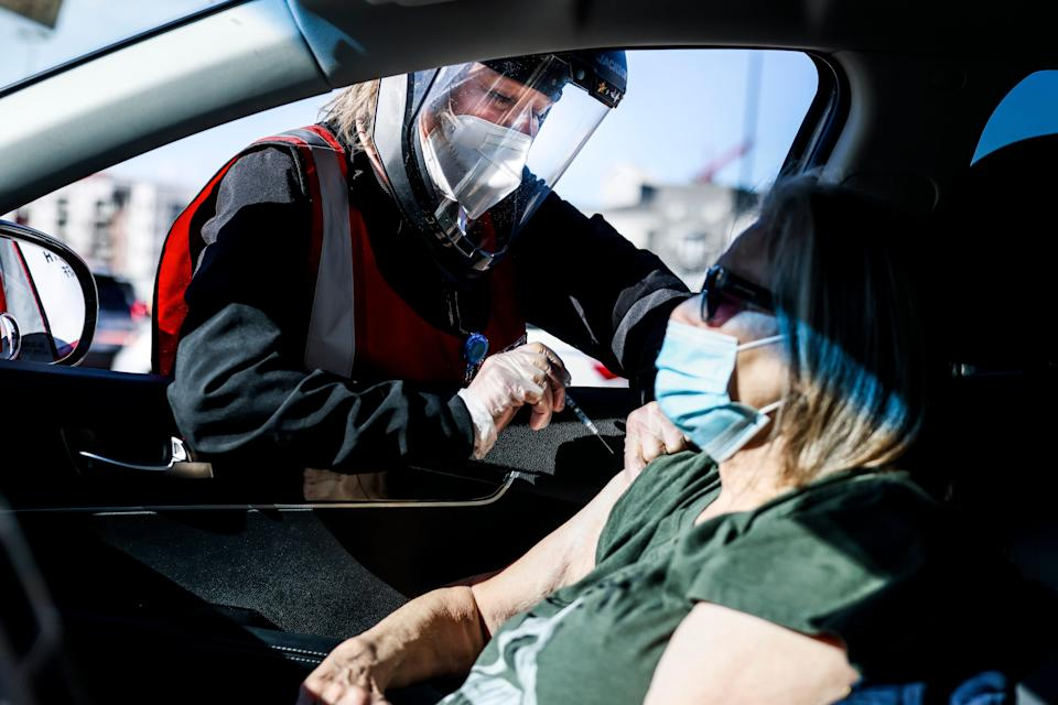 Health registered nurse Karen Nerger administers a dose of the Pfizer-BioNTech vaccine at a mass COVID-19 vaccination event on 30 January, 2021 in Denver, Colorado. Half of unvaccinated adults definitely do not want to get the jab, a new poll has found. (Getty Images)