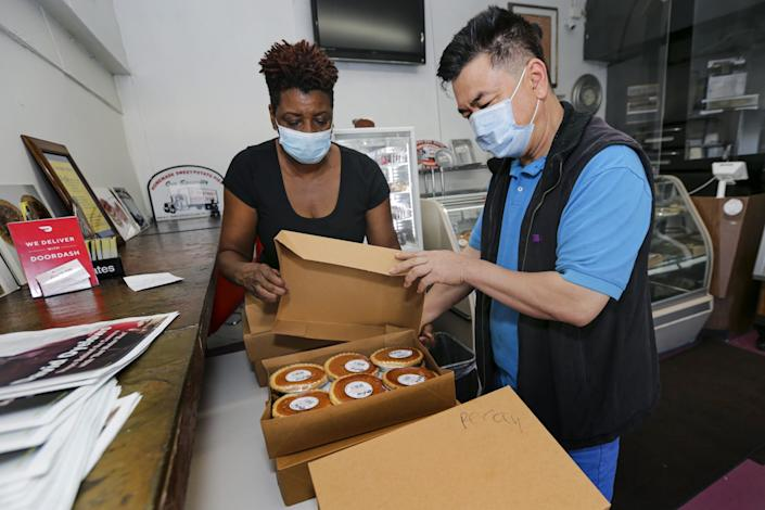 James Chong came from Long Beach to pick up pies from Jeanette Bolden-Pickens at 27th Street Bakery Shop.