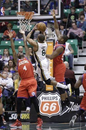 Utah Jazz's Randy Foye (8) shoots as Philadelphia 76ers' Dorell Wright (4) and teammate Lavoy Allen, right, defend in the first quarter during an NBA basketball game Monday, March 25, 2013, in Salt Lake City. (AP Photo/Rick Bowmer)