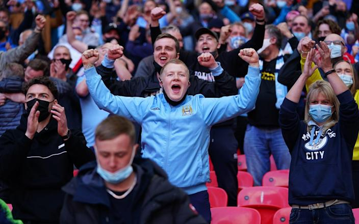 Mass events such as football matches, concerts, music festivals and big business conferences are likely to have to check the Covid status of attendees - Matt McNulty/Manchester City FC via Getty Images