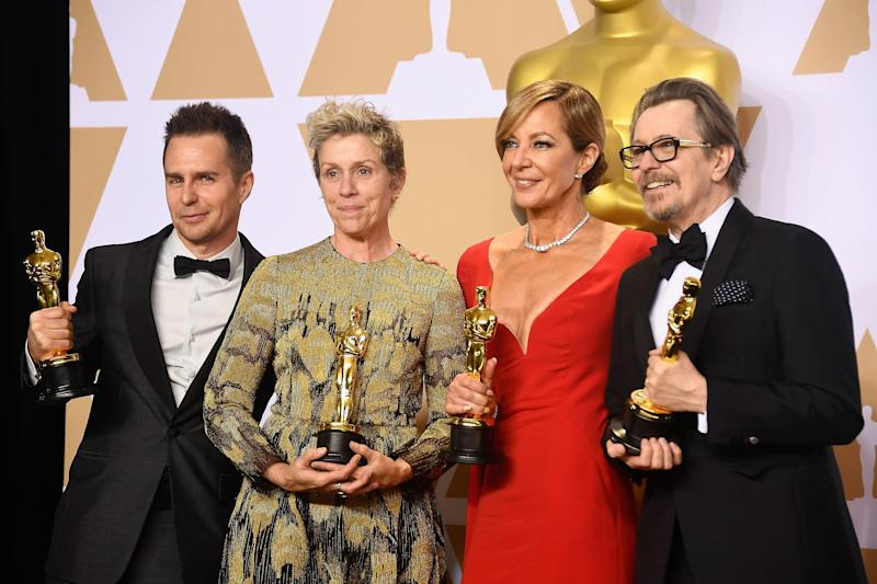 Frances McDormand, second from left, poses with her prized Oscar, which later would get lost.