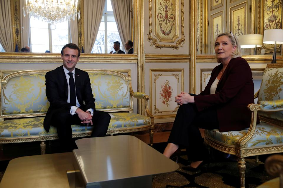 FILE PHOTO: French President Emmanuel Macron attends a meeting with French far-right National Rally (Rassemblement National) party leader Marine Le Pen at the Elysee Palace in Paris