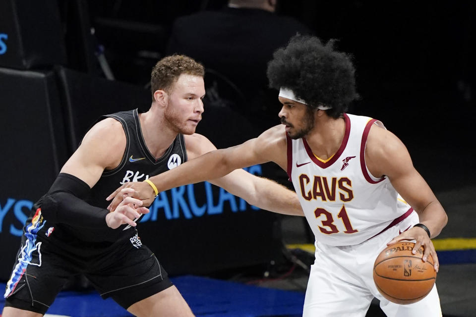 Brooklyn Nets' Blake Griffin, left, defends against Cleveland Cavaliers' Jarrett Allen during the first half of an NBA basketball game Sunday, May 16, 2021, in New York. (AP Photo/Frank Franklin II)