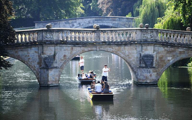 On a punt along the river Cam in Cambridge - Neil Hall/Shutterstock