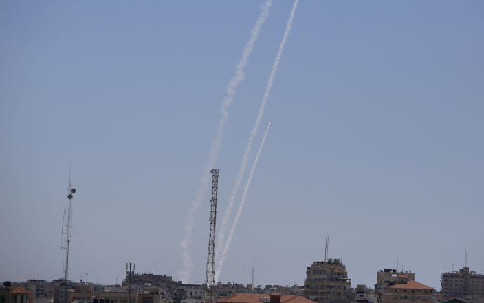 Rockets are launched from the Gaza Strip to Israel, Tuesday, May 18, 2021. Since the fighting began last week, the Israeli military has launched hundreds of airstrikes it says are targeting Hamas' militant infrastructure, while Palestinian militants have fired thousands of rockets into Israel. (AP Photo/Hatem Moussa)