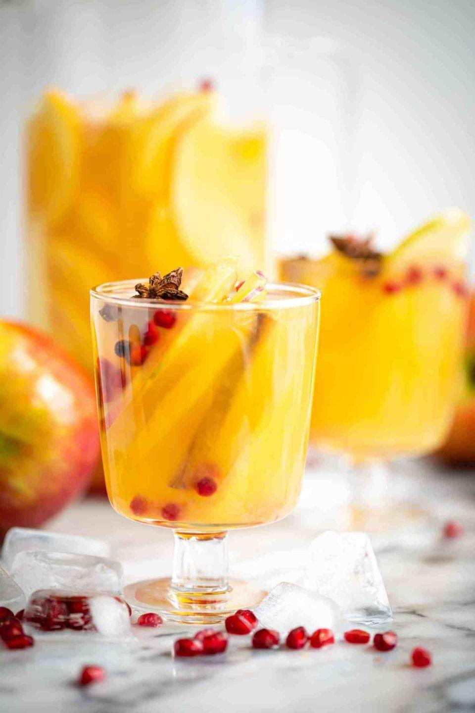 """<p>Garnish this flavorful sangria with cinnamon sticks and star anise to make it even more festive.</p><p><strong>Get the recipe at <a href=""""https://www.butterbeready.com/autumn-apple-sangria/"""" rel=""""nofollow noopener"""" target=""""_blank"""" data-ylk=""""slk:Butter Be Ready"""" class=""""link rapid-noclick-resp"""">Butter Be Ready</a>.</strong></p><p><a class=""""link rapid-noclick-resp"""" href=""""https://go.redirectingat.com?id=74968X1596630&url=https%3A%2F%2Fwww.walmart.com%2Fsearch%2F%3Fquery%3Dpioneer%2Bwoman%2Bpitcher&sref=https%3A%2F%2Fwww.thepioneerwoman.com%2Ffood-cooking%2Fmeals-menus%2Fg33510531%2Ffall-cocktail-recipes%2F"""" rel=""""nofollow noopener"""" target=""""_blank"""" data-ylk=""""slk:SHOP PITCHERS"""">SHOP PITCHERS</a> </p>"""