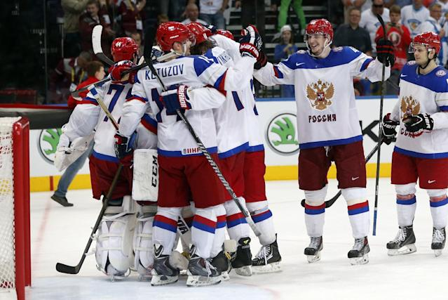 Russia players celebrate their victory in a semifinal match between Russia and Sweden at the Ice Hockey World Championship in Minsk, Belarus, Saturday, May 24, 2014. (AP Photo/Darko Bandic)