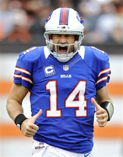 Buffalo Bills quarterback Ryan Fitzpatrick reacts after throwing a 9-yard touchdown pass to wide receiver Steve Johnson in the fourth quarter of an NFL football game against the Cleveland Browns, Sunday, Sept. 23, 2012, in Cleveland. (AP Photo/David Richard)